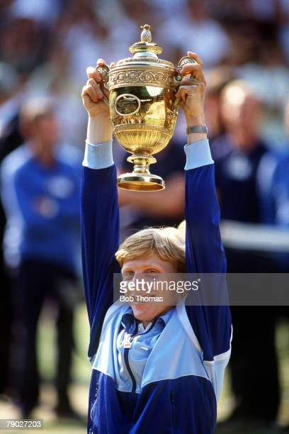 Sport AllEngland Lawn Tennis Championships Wimbledon London England 7th July 1985 Mens Final West Germany's Boris Becker holds the trophy aloft and...
