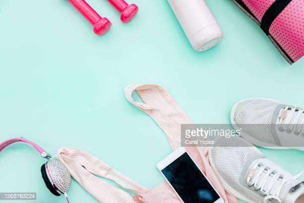 sport and fitness equipment in turquoise background - kilogram stock pictures, royalty-free photos & images