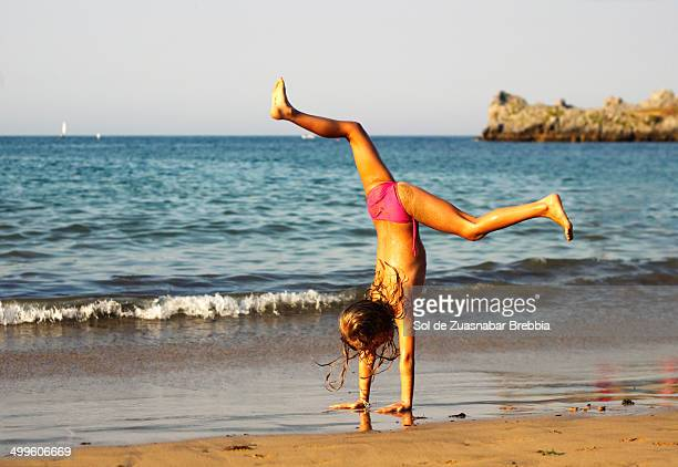 sport and gym at the beach. girl handstand on sand - bikini bottom stock pictures, royalty-free photos & images