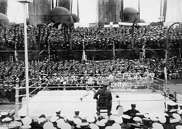Sport and Leisure During The First World War A Middleweight bout at the Grand Fleet Boxing Tournament in 1918 between Chief Carpenter's Mate Gartner...