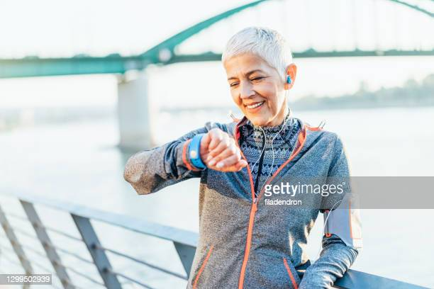 sport and technologies - white hair stock pictures, royalty-free photos & images