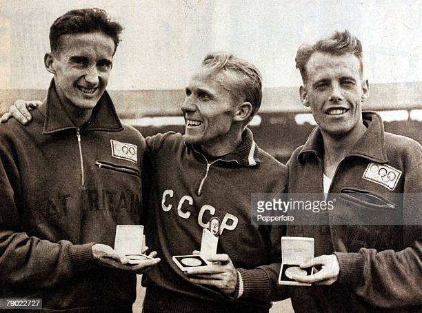 Sport Athletics 1956 Olympic Games Melbourne Australia Mens 5000 metres Russia's Vladimir Kuts Gold flanked by Great Britain pair Gordon Pirie left...