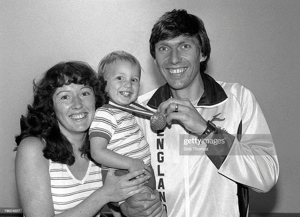 Sport. Athletics. 1982 Commonwealth Games. Brisbane, Australia. Men's 5000 Metres. England's 5000 Metres Champion David Moorcroft shows off his gold medal with his family. : News Photo