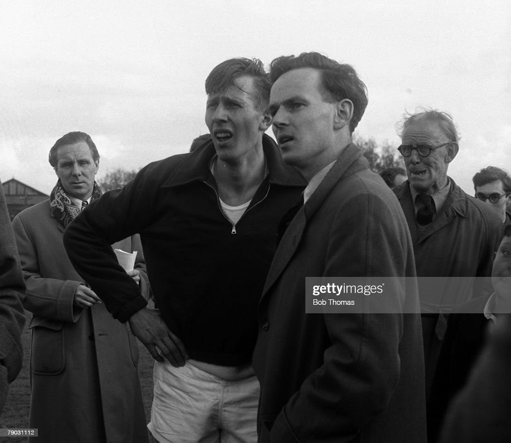Sport, Athletics, Four Minute Mile, Iffley Road, Oxford, England, 6th May 1954, Great Britain's Roger Bannister (left) is pictured with announcer and representative of the Guiness Book of Records Norris McWhirter as they wait to receive official confirmation of Bannister's new record time of 3 minutes 59,4 seconds