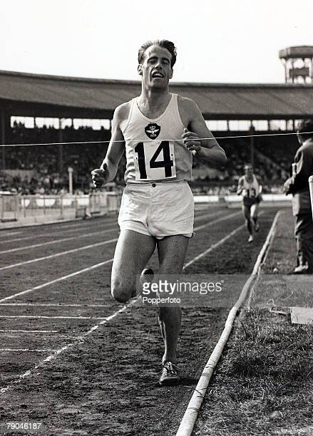 6th August 1957 British athlete Derek Ibbotson breasts the tape to win the invitation mile race at the White City Stadium