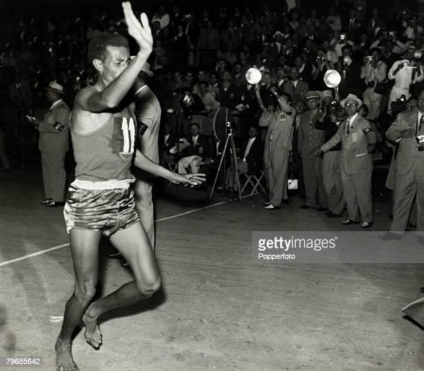 September 1960 1960 Olympic Games in Rome Ethiopia's barefoot runner Abebe Bikila celebrates winning the gold medal in the Men's Marathon as he...