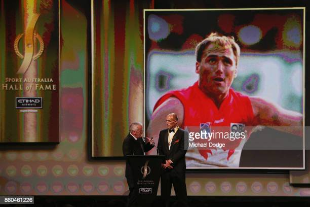Sport Australia Hall of Fame Inductee and legend AFL footballer Tony Lockett speaks on stage at the Annual Induction and Awards Gala Dinner at Crown...