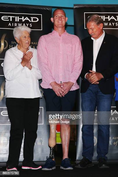 Sport Australia Hall of Fame Inductee and legend basketballer Troy Sachs poses with sporting legends Dawn Fraser and John Bertrand at the National...