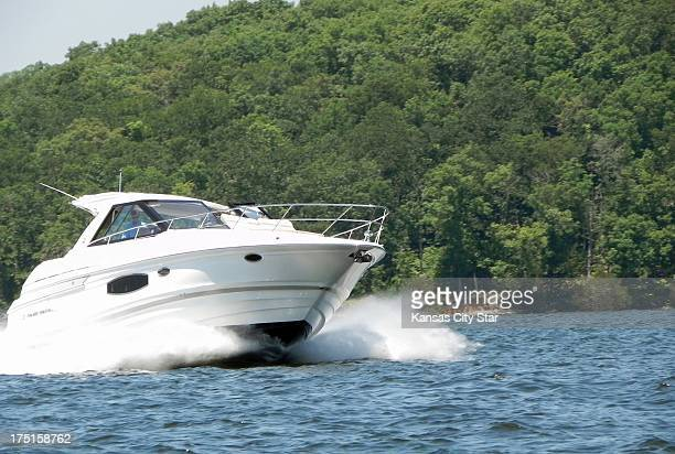 A sport boat cuts through the water as it makes its way down the main channel at Lake of the Ozarks
