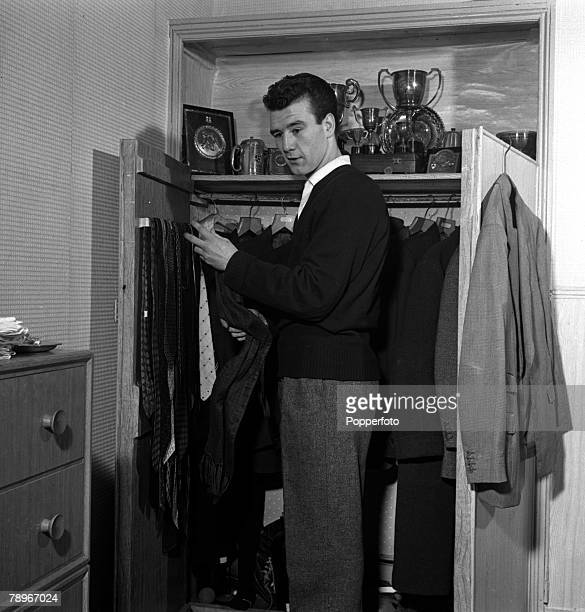 Sport Boxing England British Champion Boxer Peter Waterman the brother of actor Dennis Waterman is pictured getting dressed in his bedroom