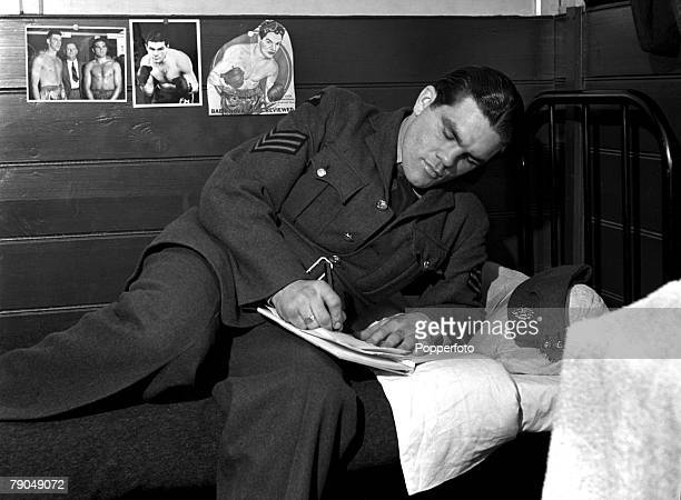 Sport Boxing England Sgt Freddie Mills of the RAF writes while relaxing on his bed Freddie later became Light Heavyweight World Boxing Champion