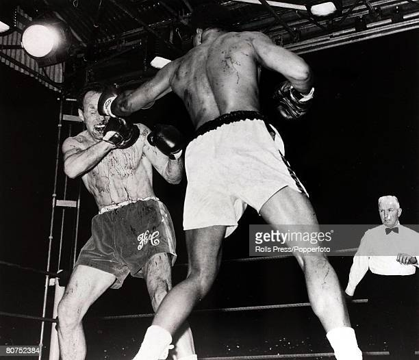 Sport, Boxing, Highbury Stadium, London, England, 21st May 1966, British heavyweight boxer Henry Cooper is covered in blood as he is caught by a left...