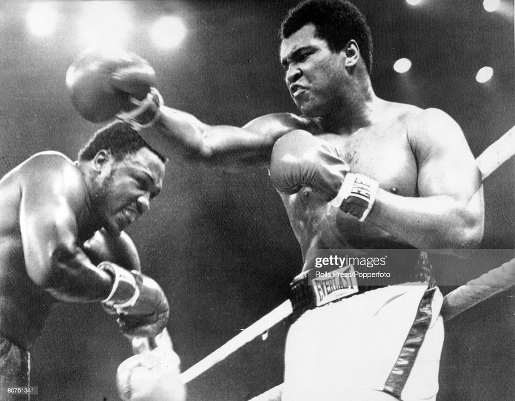 1st October 1975, World Heavyweight Championship, The 'Thrilla in Manila', Seventh Round, Heavyweight Champion Muhammad Ali, right who beat challenger Joe Frazier on a TKO, in the 14th round