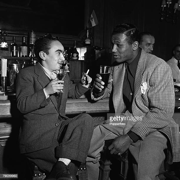 Sport Boxing Paris France American boxer Sugar Ray Robinson the World Welterweight boxing champion pictured in a Paris bar enjoying a drink with new...