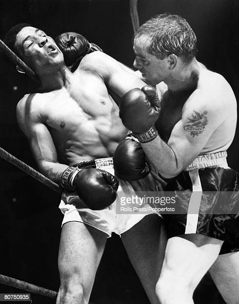 21st October 1953 World Middleweight Championship at Madison Square Garden New York Carl 'Bobo' Olson USA right pins Great Britain's Randolph Turpin...