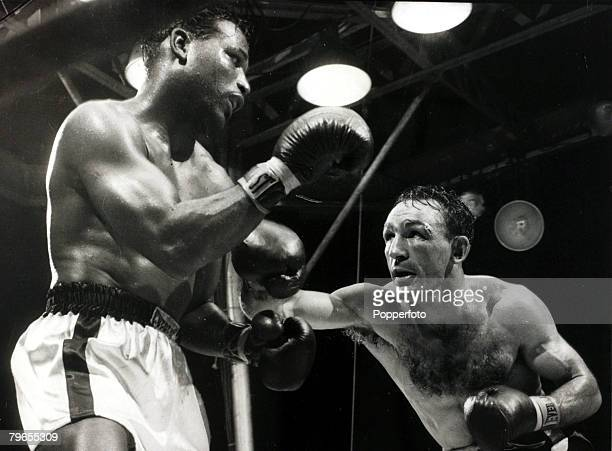 25th September 1957 World Middleweight Championship in New York The challenger Carmen Basilio throws a right which the champion Sugar Ray Robinson...