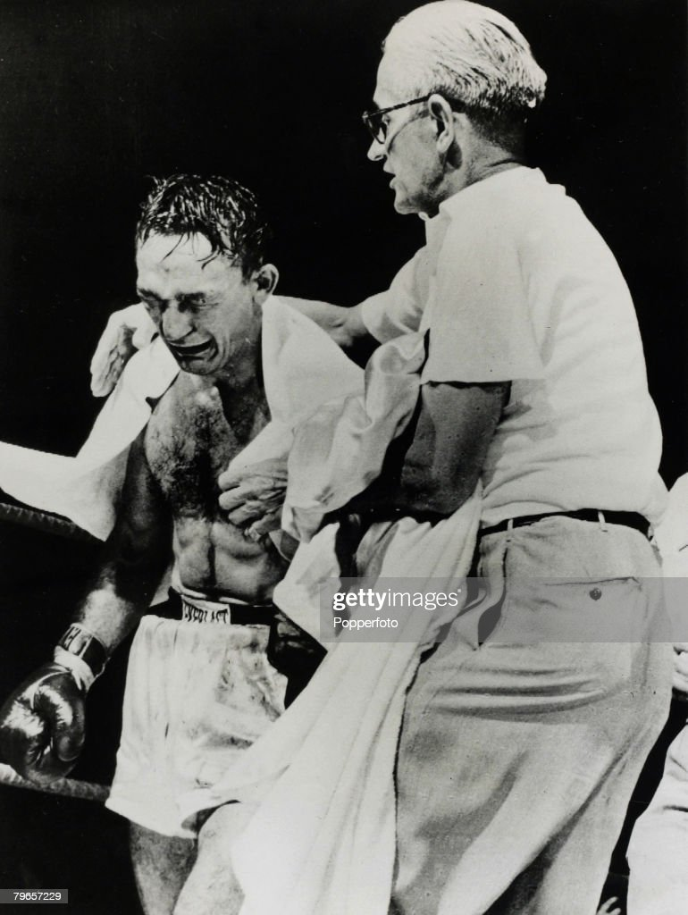 Sport, Boxing, pic: 25th September 1957, World Welterweight Championship in Syracuse, New York, Carmen Basilio cries with emotion after a TKO victory over Johnny Saxton to gain the championship title : News Photo