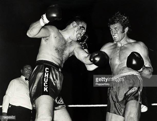 8th September 1970, Heavyweight Boxing at Wembley, British fighter Joe Bugner, right, catches American Chuck Wepner with a right hook prior to the...