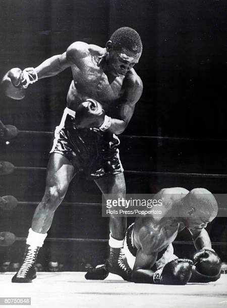 May 1965 Nigerian born boxer Dick Tiger the former Middleweight Champion of the World stands over Rubin Hurricane Carter after knocking him to the...
