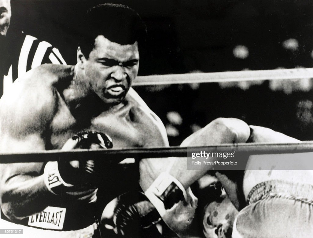 Sport Boxing. World Heavyweight Championship. Kinshasa, Zaire. 29th October 1974. Muhammad Ali on the attack with a left-right combination to send George Foreman to the canvas on his way to regaining the World Heavyweight title. : News Photo