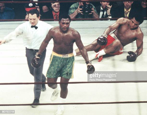 Sport Boxing World Heavyweight Championship New York pic 8th March 1971 Joe Frazier USA left led to a neutral corner by the referee after Frazier...