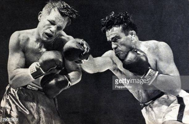 Sport Boxing World Middleweight Championship 21st September 1948 France's Algerian born Marcel Cerdan grimaces from a strong right from America's...