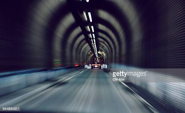 Sport car driving fast in underground tunnel