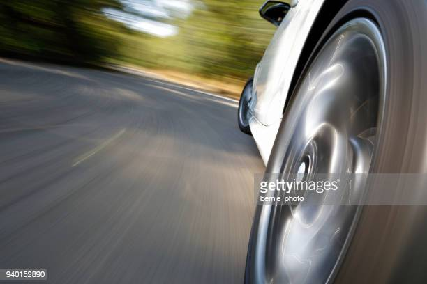 sport car driving fast - wheel stock pictures, royalty-free photos & images