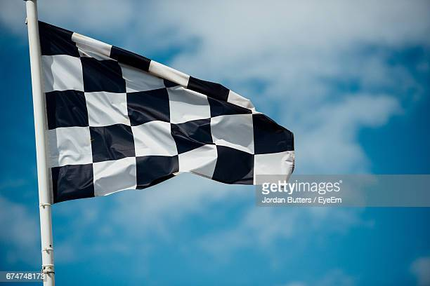 Sport Checkered Flag Against Cloudy Sky