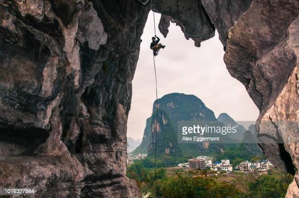 Sport climbing on limestone, in Yangshuo, Guangxi, China