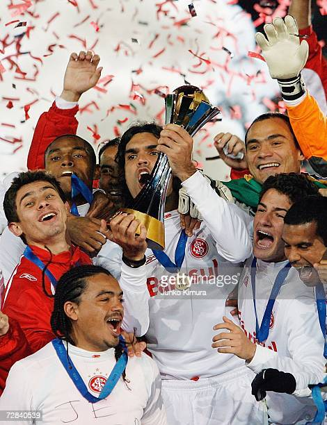 Sport Club Internaciona players celebrate with the cup after winning the final of the FIFA Club World Cup Japan 2006 between Sport Club Internacional...