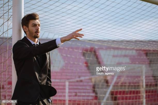 Sport coach on field