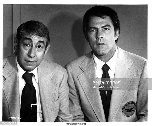 Sport commentators Howard Cosell and Frank Gifford look on during the movie 'TwoMinute Warning' circa 1976 in Los Angeles California