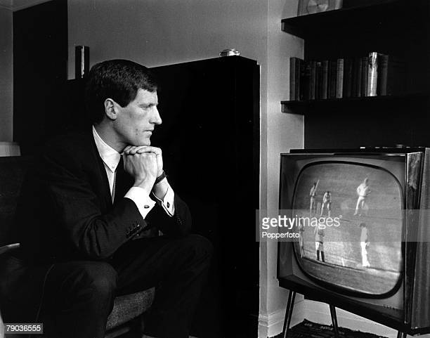 Sport Cricket and Football England 30th April 1964 West Ham goalkeeper and Worcestershire cricketer Jim Standen watches cricket on a television set...