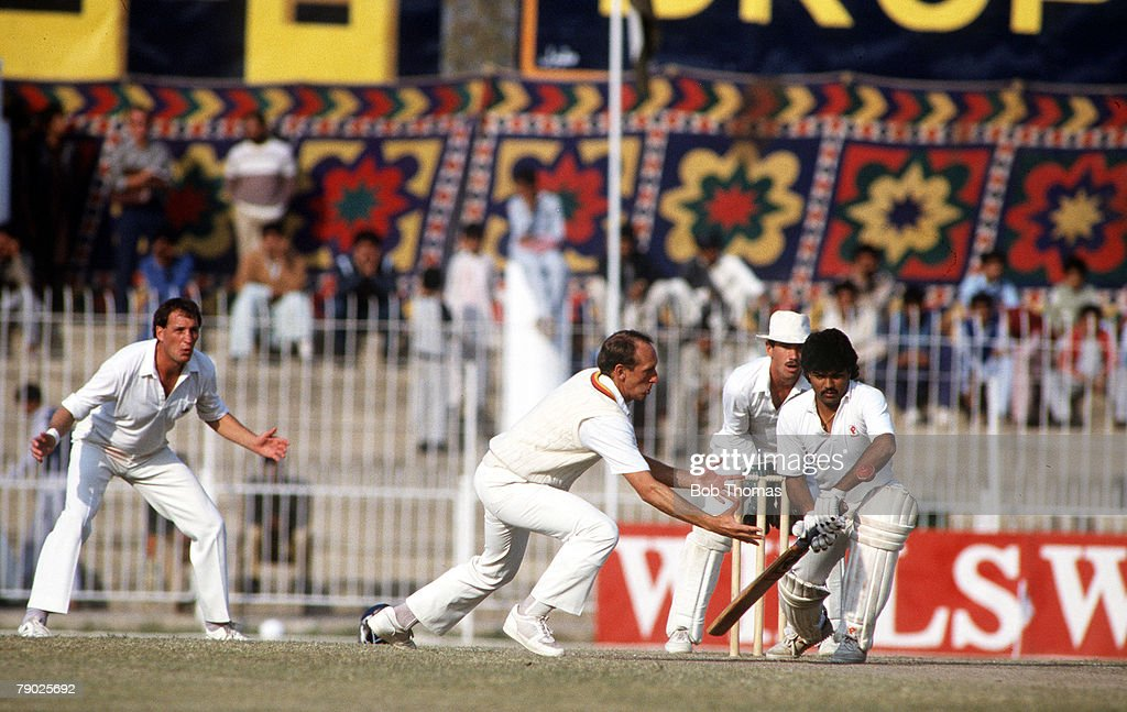 Sport. Cricket. England Tour of Pakistan. Second Test Match. Faiselabad. 7th-12th December 1987. Pakistan drew with England. Pakistan's Ijaz Ahmed plays forward while England's Bill Athey fields the ball. : News Photo