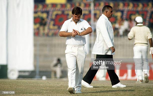 December 1987 2nd Test Match in Faisalabad Pakistan v England Match Drawn England captain Mike Gatting with Pakistan umpire Shakoor Rana During the...