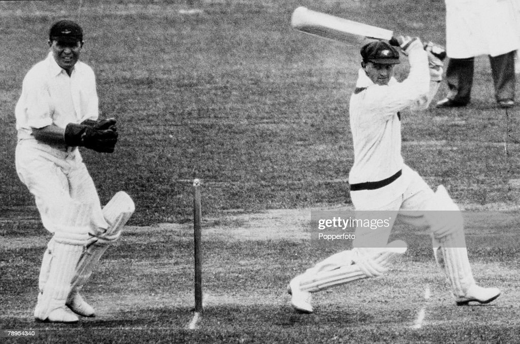 June 1934, MCC, v Australia at Lord's, Australia batsman Stan McCabe hits out as wicket-keeper Les Ames watches