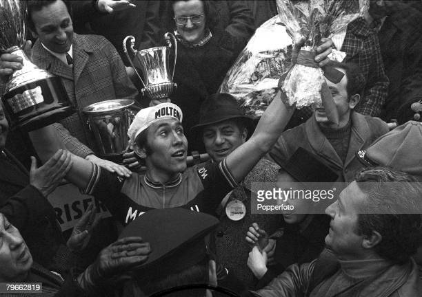 Sport Cycling Italy 22nd March 1971 Milan to San Remo Classic Belgium's Eddie Merckx shows his delight as he holds the trophy aloft after winning the...