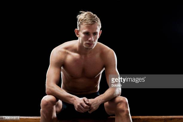sport cyclist concentrating in locker room