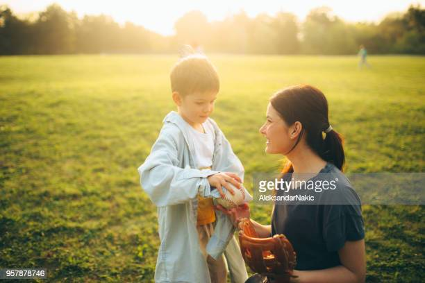 sport day outdoors with my mom - baseball mom stock pictures, royalty-free photos & images