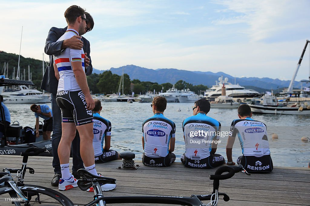 Sport director Davide Bramati talks with rider Mark Cavendish as they await their team presentation for the 100th Tour de France on June 27, 2013 in Porto Vecchio, France. The 100th Tour de France starts on Saturday from Porto Vecchio in Corsica and finishes on July 21 in Paris.