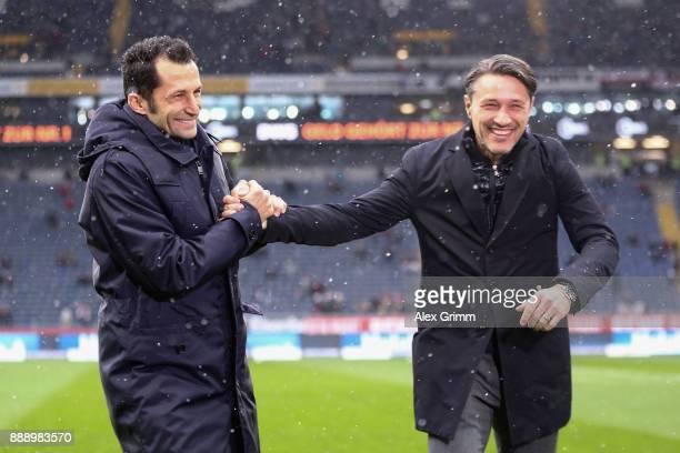 Sport director Hasan Salihamidzic of Muenchen and head coach Niko Kovac of Frankfurt shake hands prior to the Bundesliga match between Eintracht...