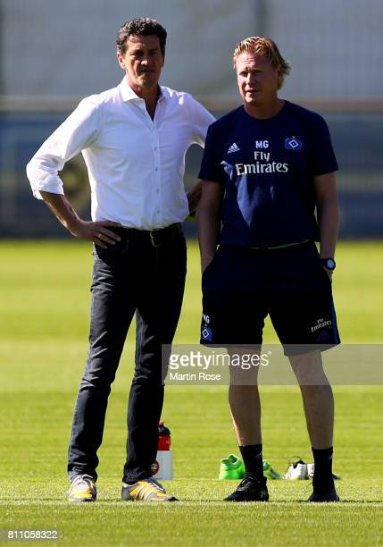 Sport director Jens Todt talks to head coach Markus Gisdol looks on during a training session of Hamburger SV at Volksparkstadion on July 9 2017 in...