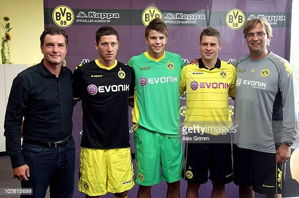 Sport director Michael Zorc and head coach Juergen Klopp pose with new players Robert Lewandowski Mitchell Langerak and Lukasz Piszczek before the...