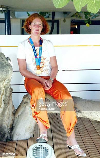 Sport / Diverses Olympische Spiele Athen 2004 Athen Deutsches Haus / Feature Rudern / Einer Katrin RUTSCHOWSTOMPOROWSKI / GER GOLD 230804