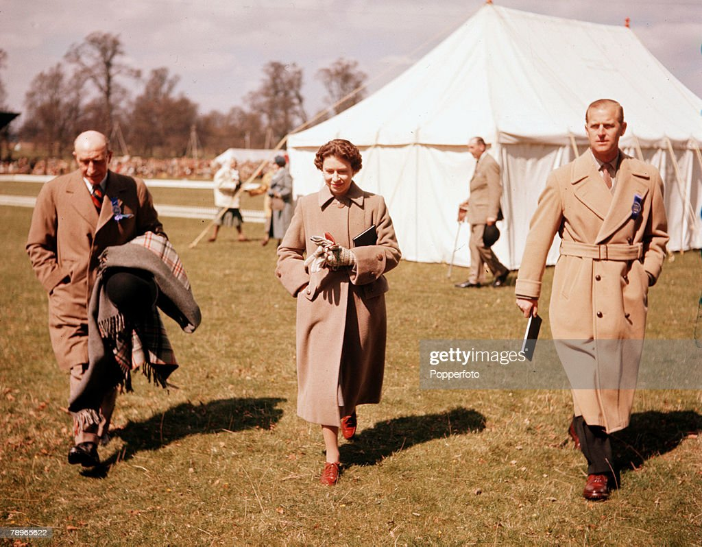 Sport. Equestrian. England. 1956. Badminton Horse Trials. Queen Elizabeth II and Prince Philip, the Duke of Edinburgh, are pictured with Lt/Col Gordon Cox (left) the Honourable Director of the Horse Trials. : News Photo