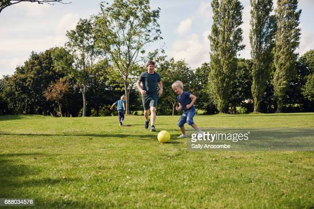 sport & family - tackling stock pictures, royalty-free photos & images