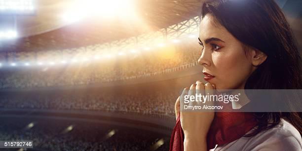 Sport fans: A girl praying