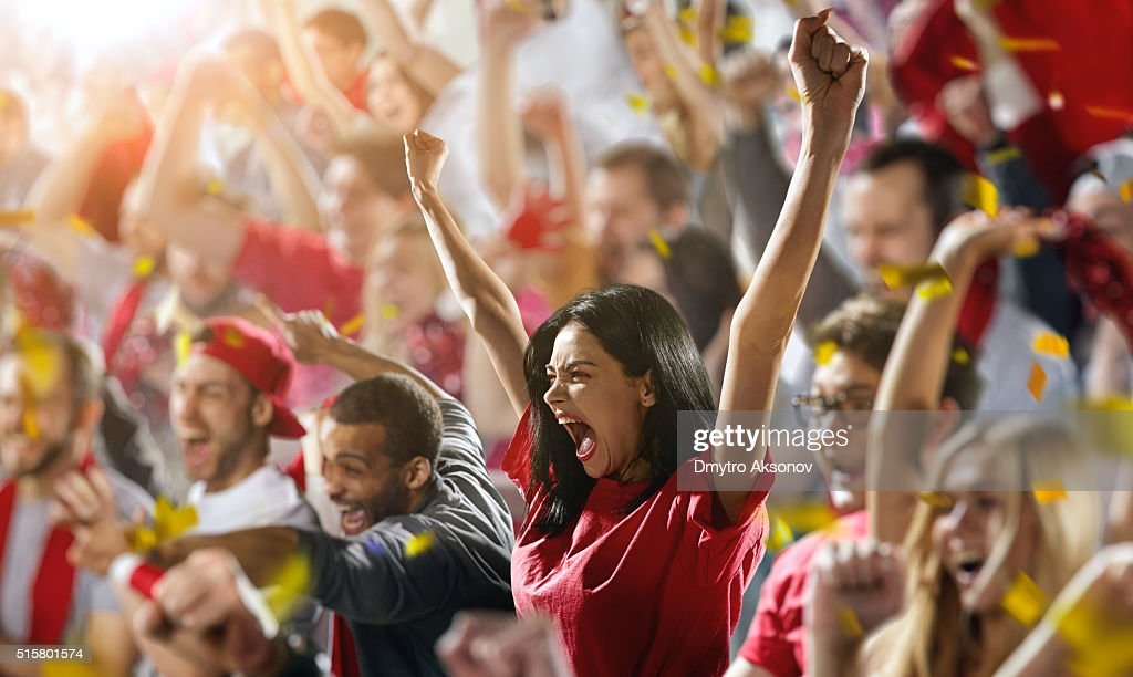 Sport fans: A girl shouting : Stock Photo