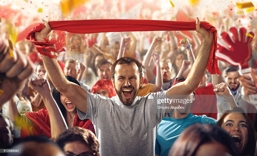 Sport fans: A man with scarf : Stock Photo
